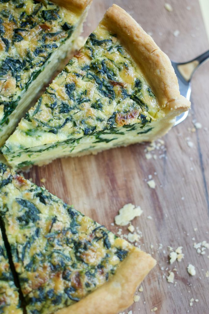Close up deep-dish spinach quiche