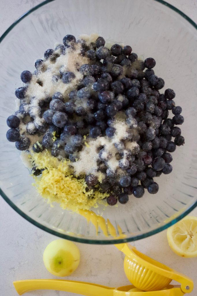 blueberries, lemon zest, and sugar in a bowl