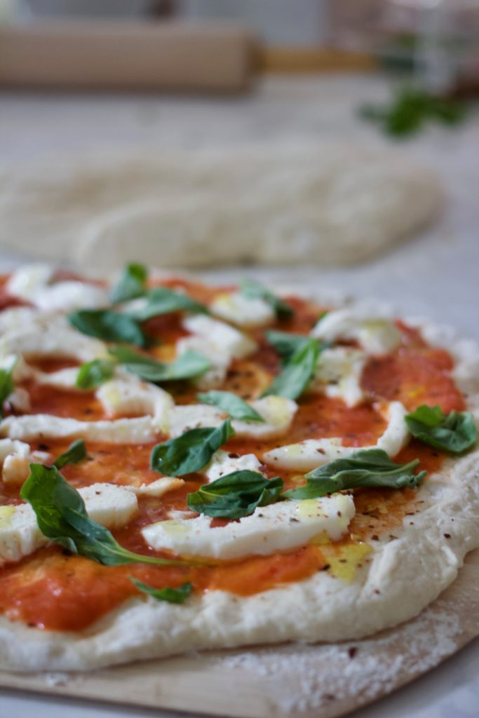 uncooked margherita pizza