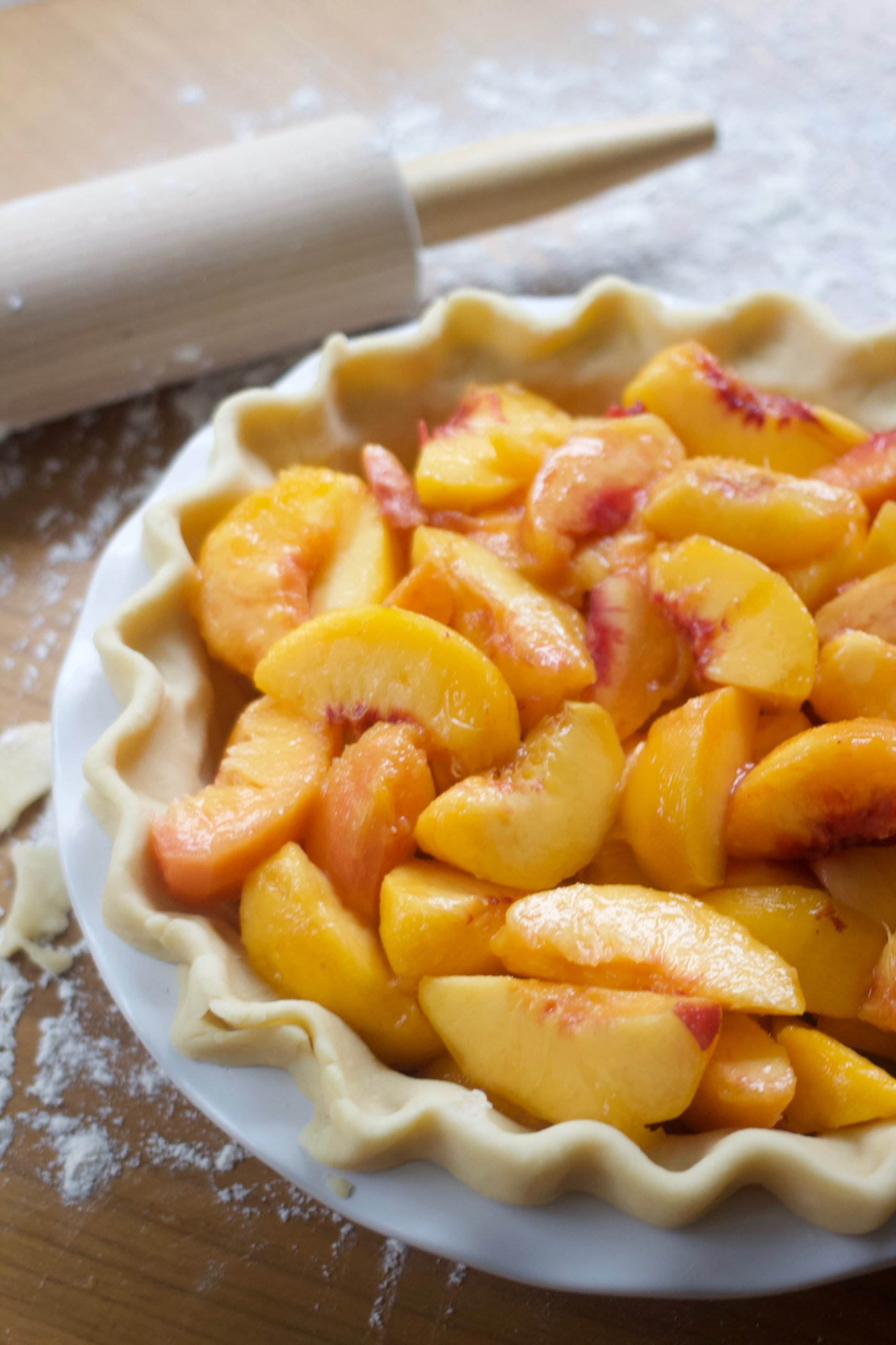 Fresh peaches in pastry-lined pie plate