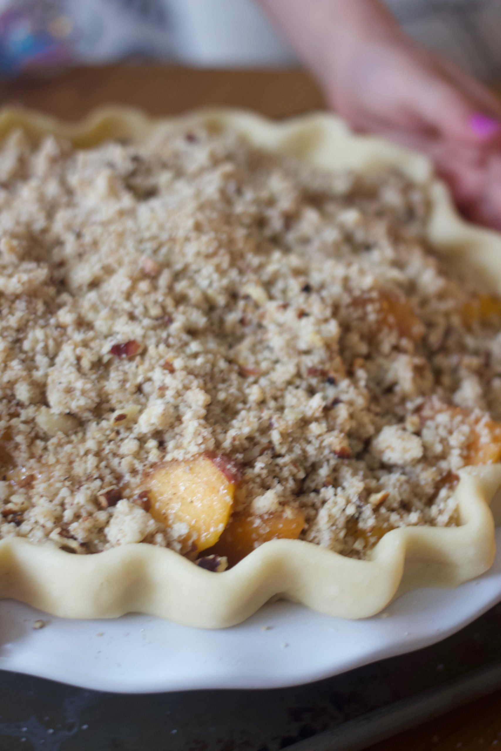 fully-assembled fresh peach pie
