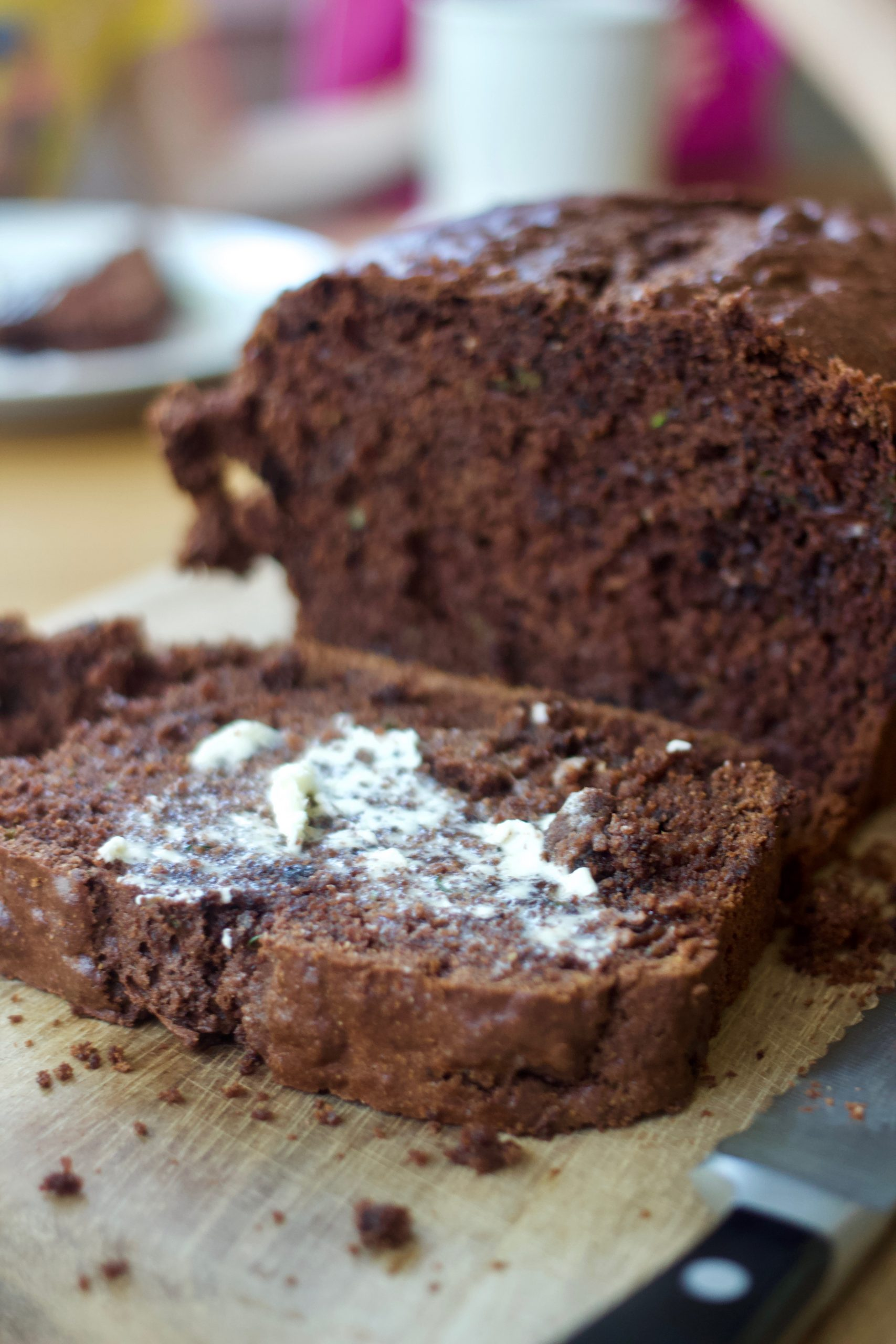 sliced chocolate zucchini bread with butter