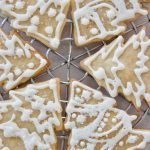 overhead of royal icing on christmas tree cut-out cookies